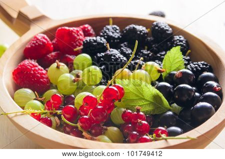 Assorted Fresh Garden Berries On A Wooden Background