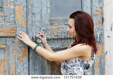 Girl Opens A Very Old Door