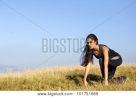 beautiful woman in start position in nature