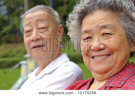 Portrait Of Happy Grandfather And Grandmother