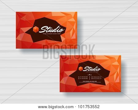 Creative professional horizontal business card, name card or visiting card set with origami abstract design in orange color.