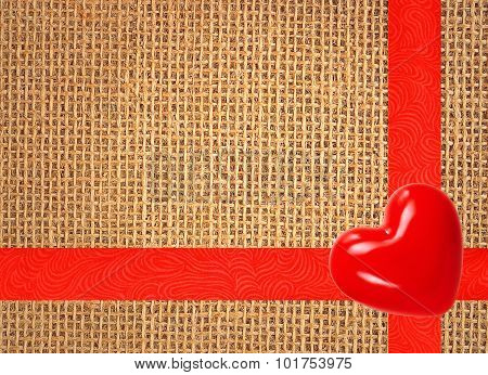 Linen Texture Background With Red Ribbon And Red Heart
