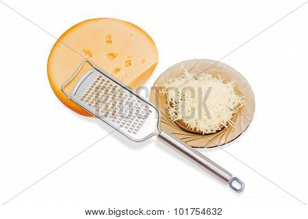 Piece Of Cheese, Grater And Grated Cheese On A Saucer