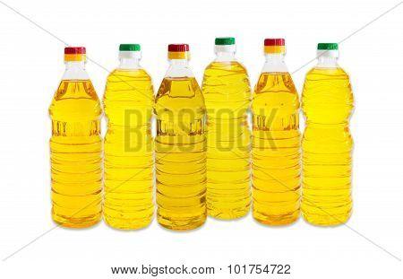 Several Bottles Of Sunflower Oil On A Light Background