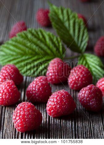 Raspberries fresh organic summer food. Healthy vegetarian diet sweet dessert. Superfoods. Dark food