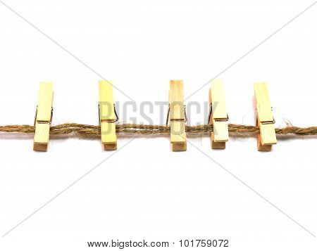 wooden cloth pegs isolated on white background