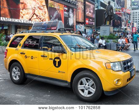 NEW YORK,USA - AUGUST 14,2015 : Typical yellow cab at Times Square in Manhattan