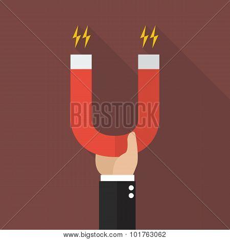 Businessman Holding Magnet