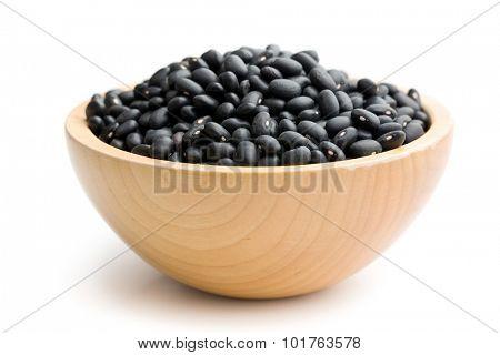 black beans in bowl on white background