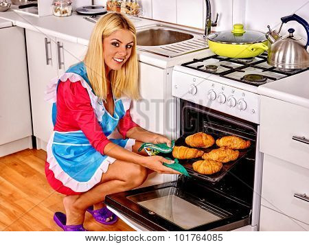 Young woman bake cookies at home kitchen.