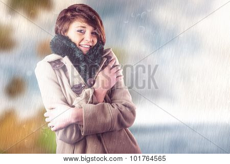 Portrait of beautiful woman in winter coat against autumn turning to winter