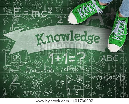 The word knowledge and casual shoes against green chalkboard