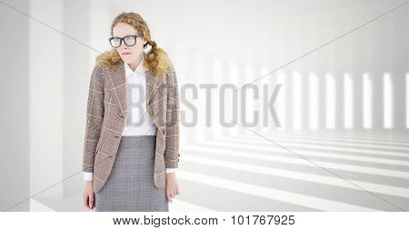 Geeky hipster woman looking nervous against curved white room