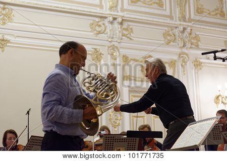 ST. PETERSBURG, RUSSIA - SEPTEMBER 7, 2015: Virtuoso horn players Hermann Baumann (right) and Javier Bonet on the rehearsal with symphonic orchestra Nevsky during International festival of French horn