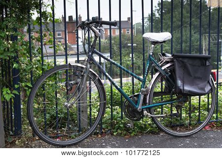 Commuter Bicycle Attached To Railings