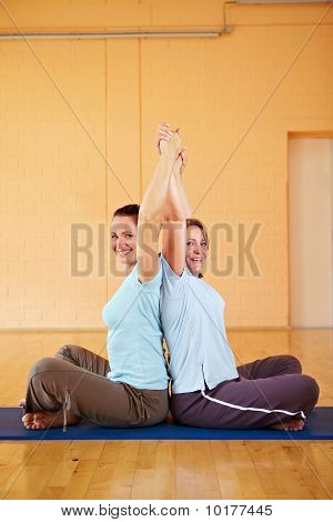 Women Stretching Arms In Gym