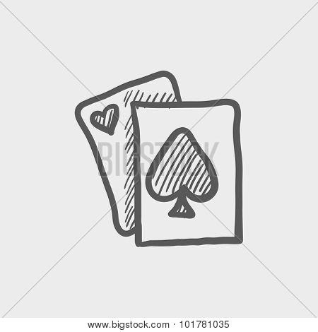Playing cards sketch icon for web, mobile and infographics. Hand drawn vector dark grey icon isolated on light grey background.