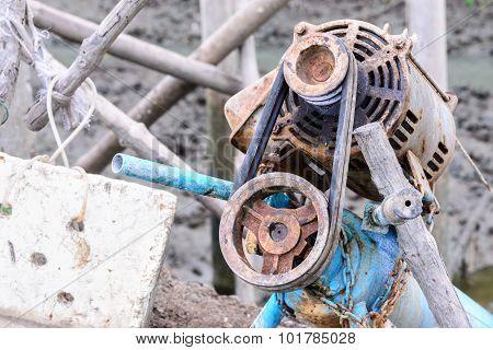 Rusty Electric Motor Of Water Turbine In Factory.