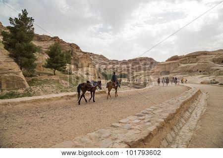 Bedouins On Horseback In Petra,  Jordan
