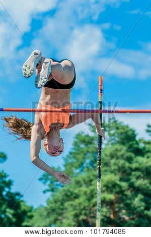 Girl athlete pole vault