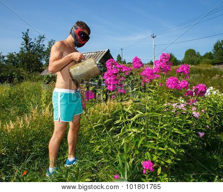 Brutal Funny Man In Helmet Watering Flowers