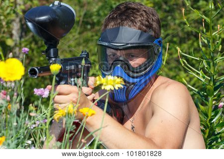 Extreme Naked Paintball Player Aiming