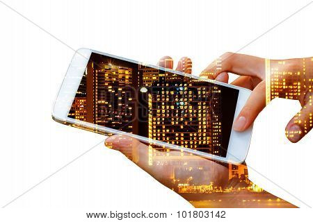 double exposure of woman hand hold and touch screen smart phone, tablet,cellphone over city night li