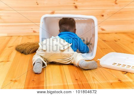 Little Active Boy Helps To Clean The House Getting Inside Bin