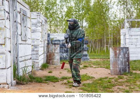 Young Woman With Paintball Marker On Training