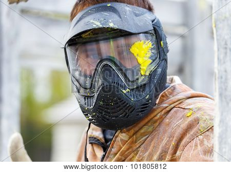 Close-up Of Male Face In Paintball Mask With Big Splash