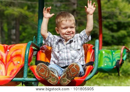 Fearless Two-years-old Boy Riding On Carousel