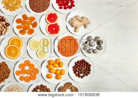 Set of orange products on wooden background