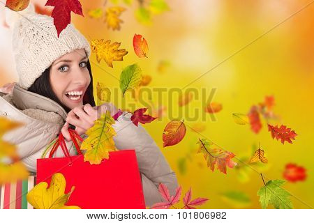 Young happy woman with shopping bags. Autumn season.