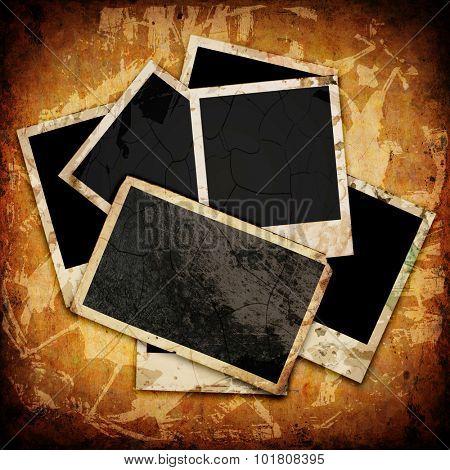 Blank photo frame on the grunge wood background