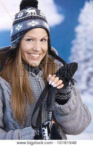 Pretty Girl Dressed Sporty For Skiing Smiling