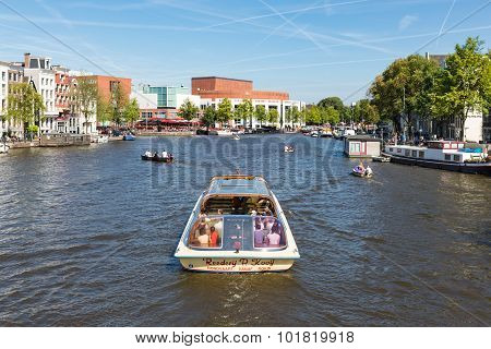 Canal With Recreating People In A Cruise Ship In Amsterdam