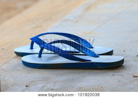 Used White And Blue Rubber Slippers