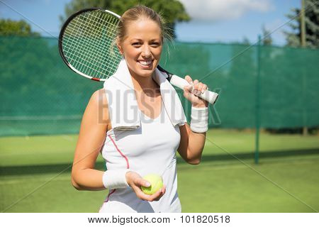 Portrait of smiling tennis player