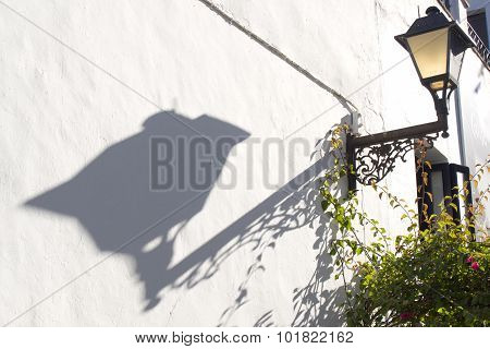 Shadow Of A Lamppost On The Wall