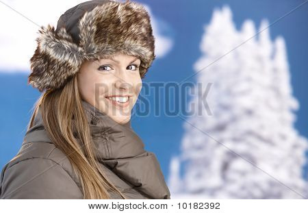 Young Woman Dressed Up For Winter Fun Smiling