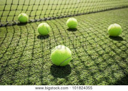 Tennis balls on the court grass