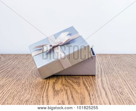 Silver gift box with a bow