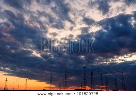 High Voltage Transmission Lines With A Stormy Sky