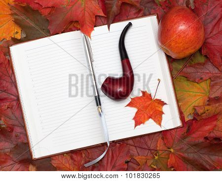 Notebook And Maple Leaves