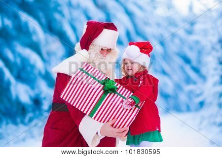 Kids And Santa With Christmas Presents