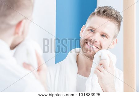 Smiling Male Drying Face