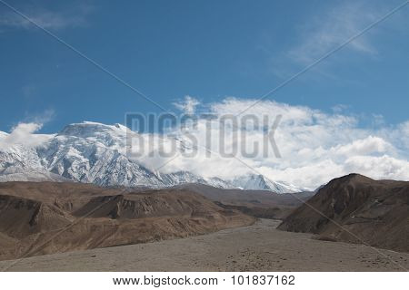 Empty Riverbed With Snow Mountain