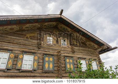 painted traditional Russian log house