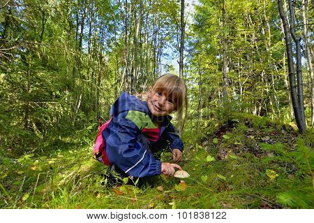 Adorable Little Girl Hiking In The Forest On Summer Day.