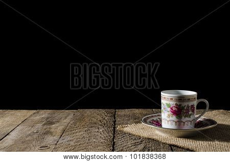 Porcelain coffee cup on wooden table